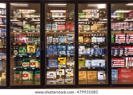 AUSTIN,US-AUG 13,2016:Various bottles of craft, microbrew, IPA, domestic and imported beers from around the world on shelf display in supermarket cooler.Alcohol drinks background, different beer style