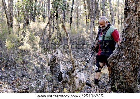 AUSTRALIA - APRIL 23: Gold miner at work detecting gold nuggets with a metal detector, April 23, 2007 - stock photo