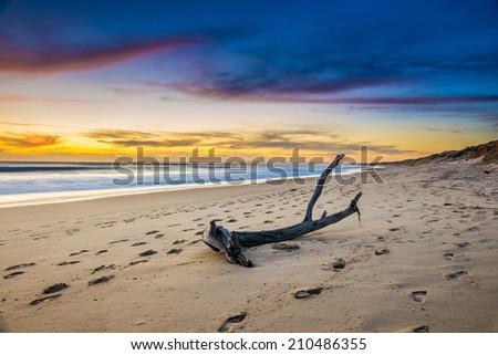 Australia beach sunrise over ocean - stock photo