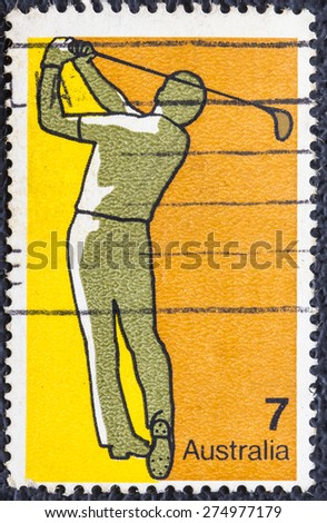 AUSTRALIA - CIRCA 1974:A Cancelled postage stamp from Australia  illustrating Australian Sports Shows a man plays Golf,  issued in 1974. - stock photo