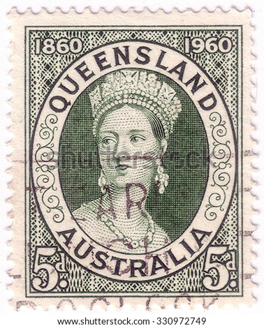 AUSTRALIA - CIRCA 1960:A Cancelled postage stamp from Australia illustrating centenary of first Queensland postage stamp, issued in 1960. - stock photo