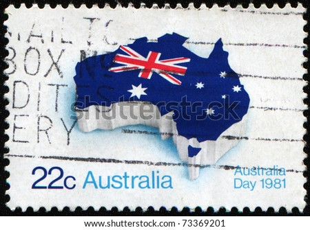 AUSTRALIA - CIRCA 1981: A stamp honoring Australia Day shows flag of Australia placed in the contour of the continent, circa 1981 - stock photo