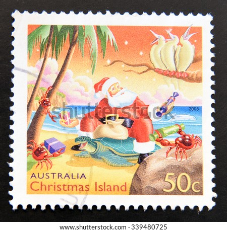 AUSTRALIA - CIRCA 2009: A stamp printed in Australia dedicated to christmas in Australia, shows Santa Claus at the beach, circa 2009 - stock photo
