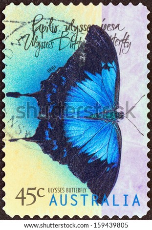 "AUSTRALIA - CIRCA 1998: A stamp printed in Australia from the ""Butterflies "" issue shows Ulysses butterfly (Papilio ulysses), circa 1998.  - stock photo"