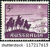 "AUSTRALIA - CIRCA 1959: A stamp printed in Australia from the ""Christmas"" issue shows the Approach of the Magi, circa 1959. - stock photo"