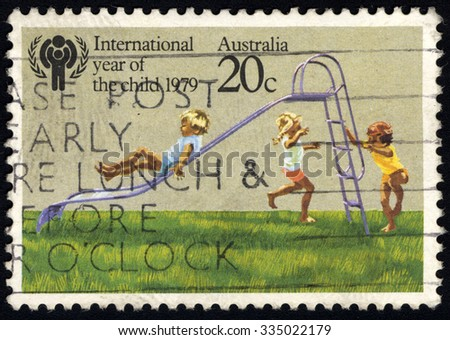 AUSTRALIA - CIRCA 1979: A stamp printed in Australia from the International Year of the Child issue shows Children playing on Slide, circa 1979.