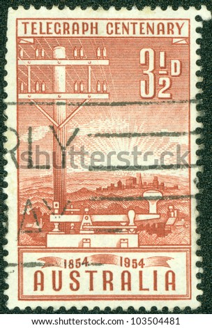 AUSTRALIA - CIRCA 1954: A stamp printed in Australia, is dedicated to Inauguration of the telegraph in Australia, shows a Telegraph Pole and Key, circa 1954 - stock photo