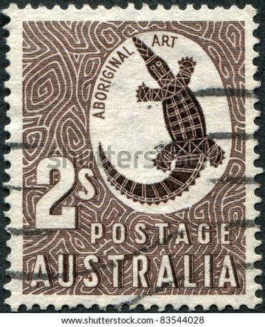 AUSTRALIA - CIRCA 1948: A stamp printed in Australia shows Aboriginal Art, Crocodile, circa 1948 - stock photo