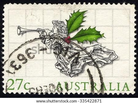 AUSTRALIA - CIRCA 1985:  A stamp printed in Australia shows angel with trumpet, Christmas 1985 series, circa 1985 - stock photo
