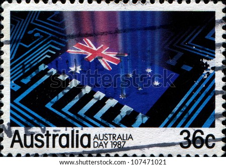 AUSTRALIA - CIRCA 1987: A stamp printed in Australia shows Australian flag at the center of computer circuitry, symbolizing the hi-tech industry of Australia, circa 1987 - stock photo
