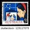 "AUSTRALIA - CIRCA 1964: A stamp printed in Australia shows child looking at Nativity Scene, with inscriptions ""Christmas, 1964"", from the series ""Christmas"", circa 1964 - stock photo"
