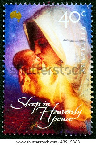 AUSTRALIA - CIRCA 2000: A stamp printed in Australia shows Christmas scene - Mother of God with child, circa 2000 - stock photo