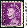AUSTRALIA-CIRCA 1971:A stamp printed in AUSTRALIA shows image of Elizabeth II (Elizabeth Alexandra Mary, born April 21, 1926) is the constitutional monarch of United Kingdom in purple, circa 1971. - stock photo