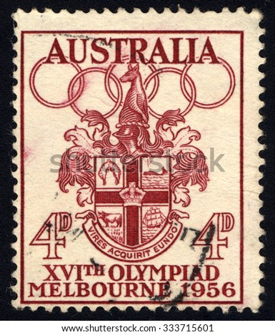 AUSTRALIA - CIRCA 1956: A stamp printed in Australia shows Melbourne Coat of Arms and the Olympic rings, circa 1956