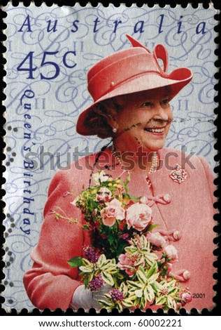 AUSTRALIA - CIRCA 2001 A stamp printed in Australia shows Queen Elizabeth II with flowers, circa 2001 - stock photo