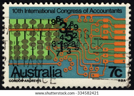 AUSTRALIA - CIRCA 1972: A Stamp printed in AUSTRALIA shows the Abacus, Numerals, Computer Circuits , 10th International Congress of Accountants, circa 1972 - stock photo
