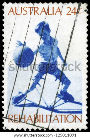 AUSTRALIA - CIRCA 1972: A Stamp printed in AUSTRALIA shows the Boy wearing Toronto splint, playing ball, Rehabilitation of the Handicapped, series, circa 1972 - stock photo