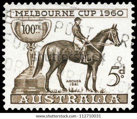 AUSTRALIA - CIRCA 1960: A Stamp printed in AUSTRALIA shows the Melbourne Cup and Archer, 1861 Winner, Centenary issue, circa 1960 - stock photo