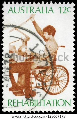 AUSTRALIA - CIRCA 1972: A Stamp printed in AUSTRALIA shows the Worker in Sheltered Workshop, Rehabilitation of the Handicapped, series, circa 1972 - stock photo