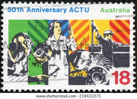 AUSTRALIA - CIRCA 1977: A Stamp printed in AUSTRALIA shows the Workers, Australian Council of Trade Unions (ACTU), 50th anniversary, circa 1977 - stock photo