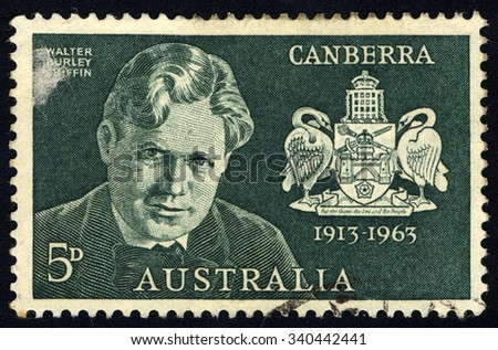 AUSTRALIA - CIRCA 1963: A stamp printed in Australia to commemorate 50 years of Canberra shows Coat of arms of Canberra & Walter Burley Griffin, circa 1963
