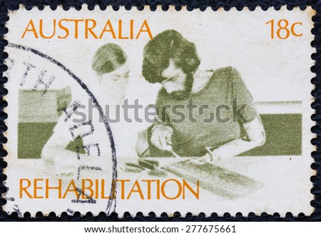 AUSTRALIA - CIRCA 1972: a stamp printed in the Australia shows Amputee Assembling Electrical Circuit, Rehabilitation of the Handicapped, circa 1972 - stock photo
