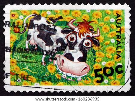 AUSTRALIA - CIRCA 2005: a stamp printed in the Australia shows Cow and Bird, Down on the Farm, Animals, circa 2005 - stock photo