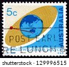 AUSTRALIA - CIRCA 1968: a stamp printed in the Australia shows Satellite Orbiting Earth, Use of Satellites for Weather Observations and Communications, circa 1968 - stock photo