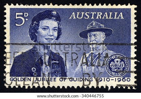 AUSTRALIA - CIRCA 1960: A stamp printed in the Australia to commemorate Golden Jubilee of Guiding (1910-1960) shows Girl Guide and Lord Baden-Powell, circa 1960 - stock photo