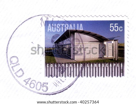 AUSTRALIA - CIRCA 2009: Australian stamp shows image of corrugated iron house,corrugated landscapes series, circa 2009 - stock photo