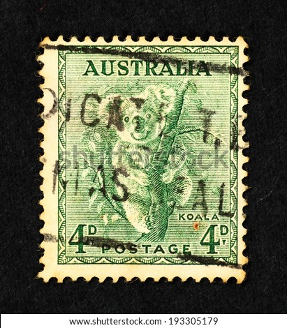 AUSTRALIA - CIRCA 1937: Green color postage printed in Australia with image of a Koala Bear on a tree branch.