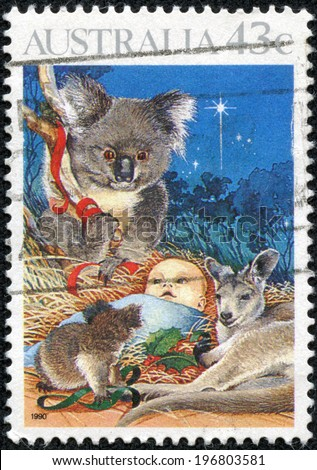 AUSTRALIA - CIRCA 1990: Postage stamp printed in Australia, Christmas Issue, shows Baby Jesus Nativity, koala and kangaroo, circa 1990 - stock photo