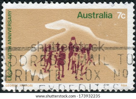 AUSTRALIA - CIRCA 1973: Postage stamp printed in Australia, dedicated to the 50th anniversary of Legacy, shows Hand Protecting Playing Children, circa 1973 - stock photo