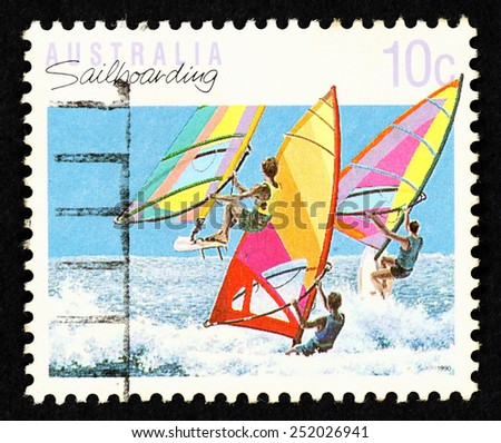 AUSTRALIA - CIRCA 1990: Postage stamp printed in Australia with image of sailboarding sportsman at sea.  - stock photo