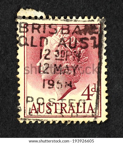AUSTRALIA - CIRCA 1958: Red color postage stamp printed in Australia with image of Queen Elizabeth II head.