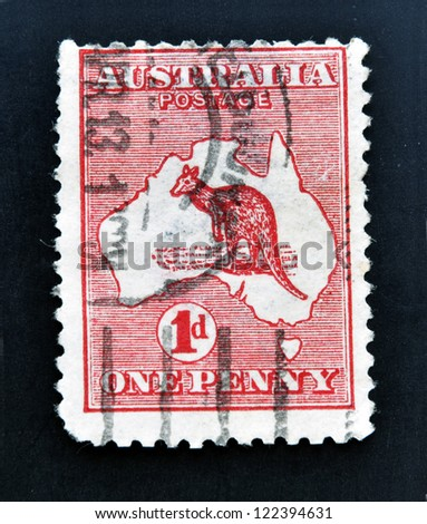 AUSTRALIA - CIRCA 1913: stamp printed in Australia shows kangaroo in the map, one penny, circa 1913 - stock photo
