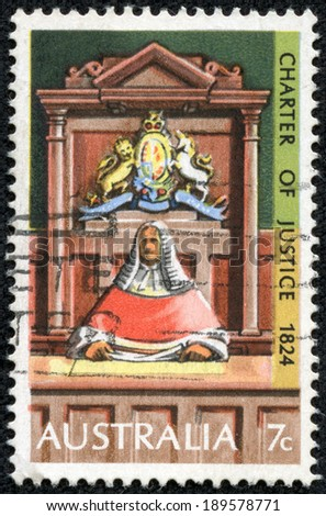 AUSTRALIA - CIRCA 1973: stamp printed in Australia shows Supreme Court Judge on Bench, circa 1973 - stock photo