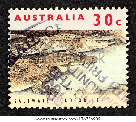 AUSTRALIA - CIRCA 1994: Stamp printed in Australia with image of a pair of Saltwater Crocodile.