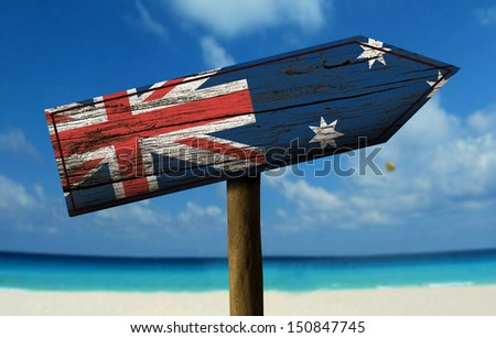 Australia flag wooden sign with a beach on background - Oceania - stock photo