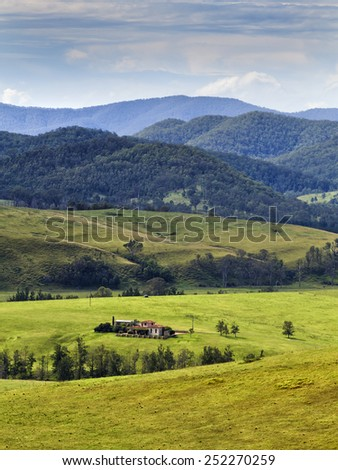 Australia NSW rural regional area near well developed agricultural farm land with green grazing fields around remote estate  - stock photo