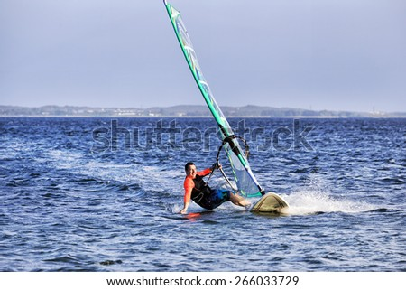 Australia pacific botany bay surfing board and sail summer sunny day man approaching high speed gliding - stock photo