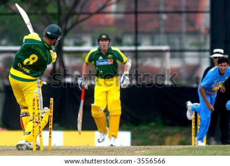 Australia's batsman was bowled out by an Indian bowler during tri-nations cricket series in Kuala Lumpur - stock photo