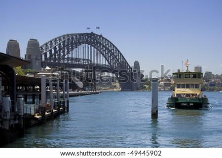 australia sydney circular quay passenger ferries terminal harbour bridge blue sky - stock photo