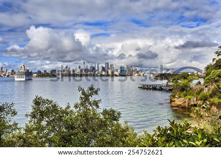 australia Sydney City CBD and harbour bridge panoramic view of major landmarks sunny summer day across harbour with green environment surrounding beach and lagoon - stock photo
