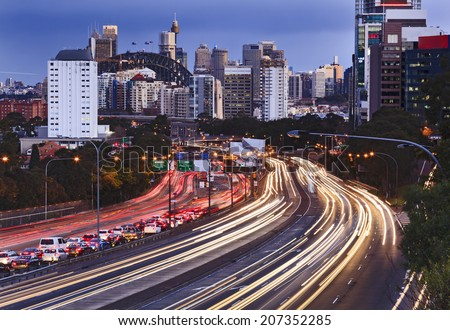 Australia Sydney city CBD close up view along Cahill express motor way rush hour with car congestions and blurred headlights  - stock photo