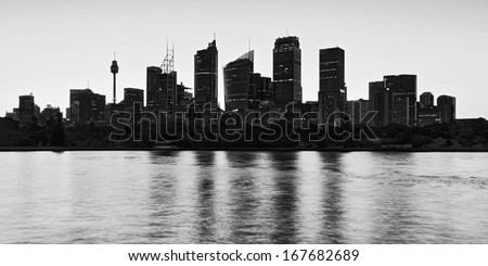 australia sydney city CBD high contrast silhouette black white panoramic view with reflection in harbour waters - stock photo