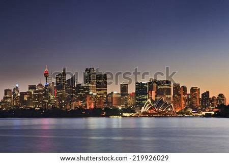 AUstralia Sydney city CBD landmarks panoramic view over harbour from Cremorne at sunset with full illumination - stock photo
