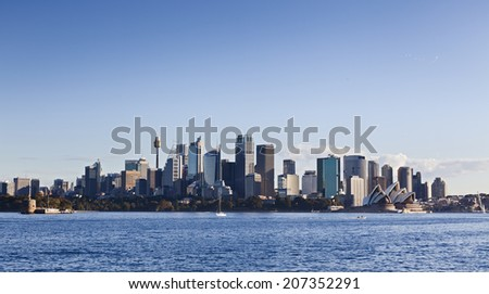 Australia sydney city CBD view from Cremorne point over blue harbour waters under clear sky - stock photo
