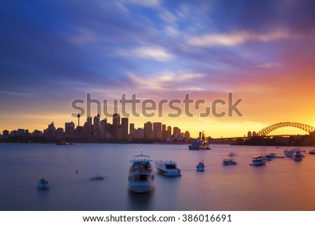 Australia Sydney city CBD view from cremorne point over harbour waters at sunset, taken by long exposure technique - stock photo