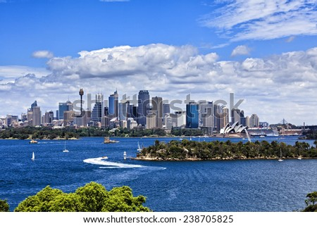 Australia Sydney city CBD view from Taronga zoo over harbour waters sunny bright summer day lush colours and white clouds in blue sky - stock photo